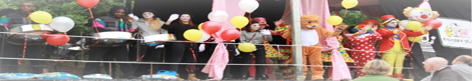Fisherfield Childcare dressed as clowns waving